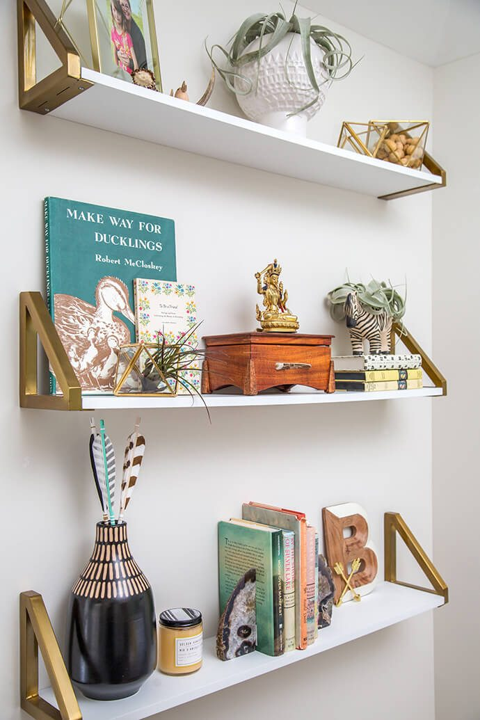 white and gold open shelves